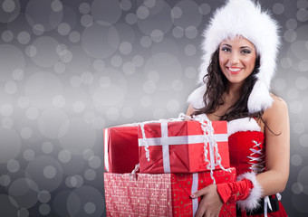 sexy santa girl in white hat  holding a gift boxes