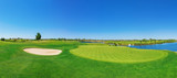 Fototapety Panorama golf course lush grass. On the lake.