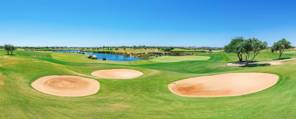 Beautiful panorama of the golf course. Summer of tourists.