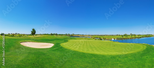 Panorama golf course lush grass. On the lake. - 72856650