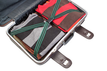 Prepared suitcase with clothing in holiday trip.