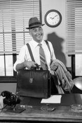 Smiling businessman arriving at office