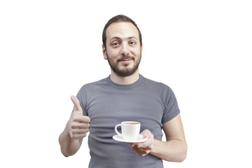young man drinking a cup of coffee or tea isolated