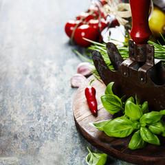 vintage herb cutting mezzaluna knife and fresh ingredients