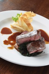 plated venison steak meal