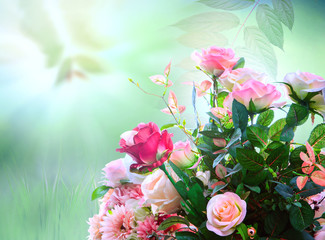 artificial roses flowers bouquet arrangement against green blur