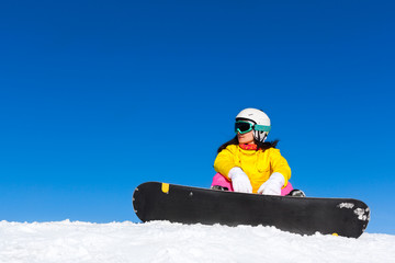snowboarder sitting snow mountain slope copy space