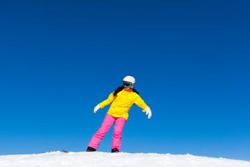 snowboarder girl making stunt trick on snowboard