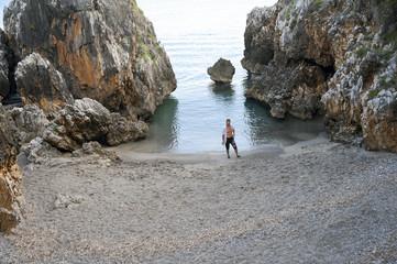 A man alone in a small cove