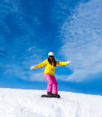 Snowboarder sliding woman down hill, snow mountains