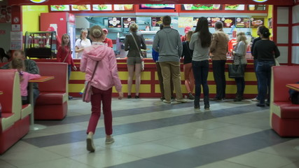 The people at the counter of a fast food