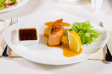 Plated Meal of Grilled Salmon with Sauce