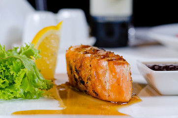 Plate of Grilled Salmon Drizzled with Sauce