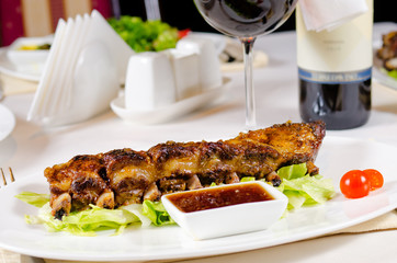 Glass of Wine Served with Ribs in Restaurant