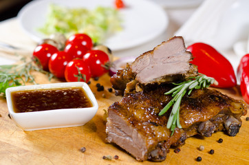 Grilled marinated ribs with spicy sauce