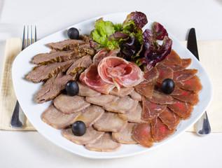 Gourmet cold meat platter on a buffet