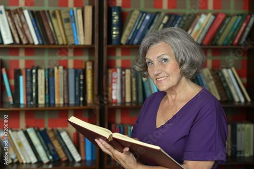 Leinwanddruck Bild Beautiful elderly woman with book
