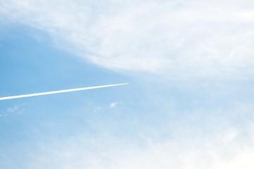 Airplane moving across blue sky