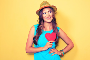 Young woman portrait holding red Heart.