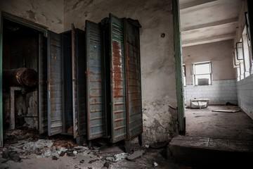 Dark room with steel lockers