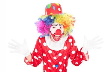 Happy male clown gesturing with hands