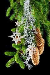 christmas tree with shiny silver decoration. festive ornaments