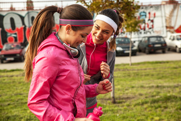 Two attractive female jogging together on beautiful morning.