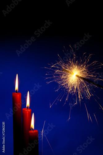 canvas print picture Flamme einer Kerze mit Wunderkerze