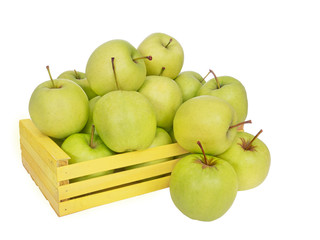 Golden Delicious apples tumble out of yellow box, isolated