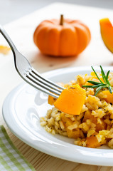 Pumpkin risotto with rosemary for healthy dinner