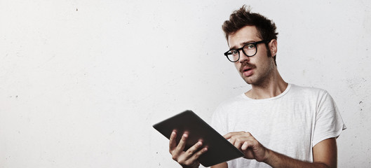 Young man with digital tablet in his hands