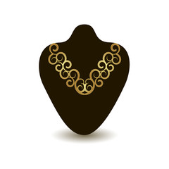 gold necklace on a black mannequin
