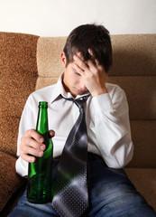 Sad Teenager in Alcohol addiction