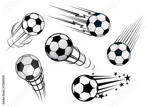 Fototapeta Speeding footballs or soccer balls