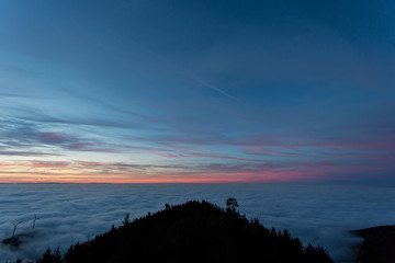 sunset over fog in black forest, Germany
