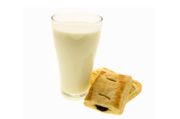 Glass of milk and bread on white background