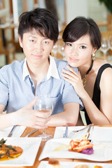 Young couple dating at a restaurant for a romantic dinner