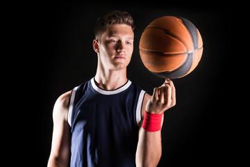 Basketball player spinning ball on finger