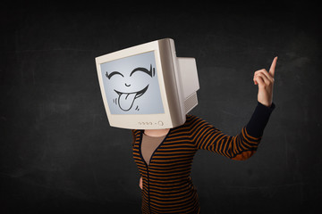 Young girl wearing a monitor with a funny face