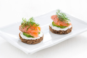 canape with cheese, cucumber and salted salmon