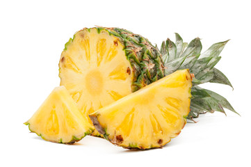 Half of pineapple and his slices isolated