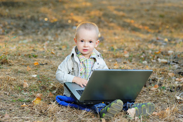 A Little Boy and a Laptop OUtdoors