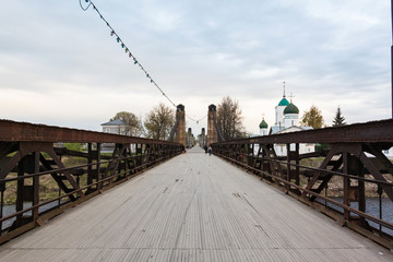 old rusty steel suspension bridge