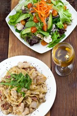 Chicken Pasta and Vegetable Salad Meal on Table