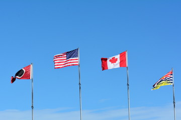 Flags of our nation fly in the breeze.