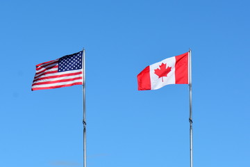 National flags of Canada and the USA.