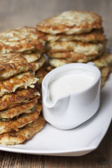 Vegetable fritters of zucchini with parsley and dill closeup  .