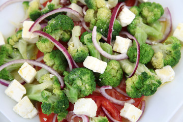 Close up of broccoli salad with tomatoes and cheese