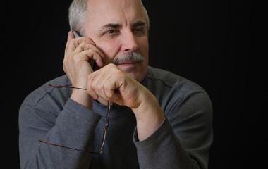 Portrait of Caucasian man listening cellular phone