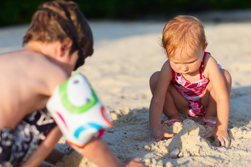 Two kids playing together at beach
